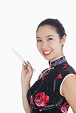 Woman smiling with chopsticks