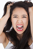 Woman screaming and pulling her hair out