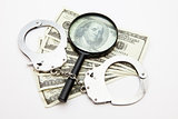 Magnifying glass money and handcuffs