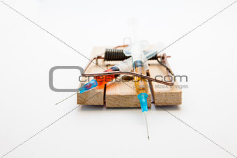 Syringes in a mousetrap