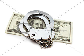 Money and handcuffs lying