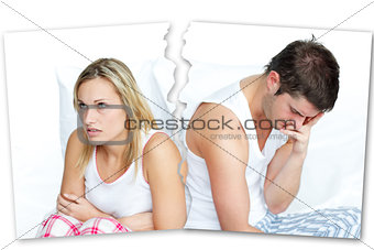 Angry couple sitting against each other