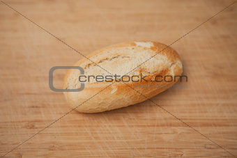 Small baguette laying on table