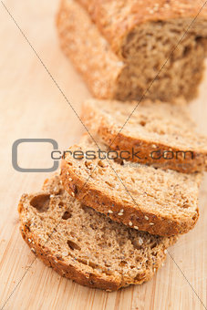 Partially sliced brown bread