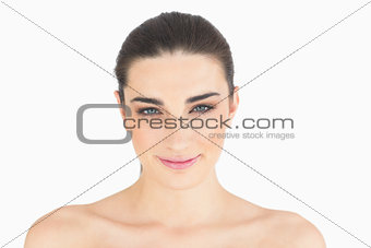 Natural woman smiling at camera