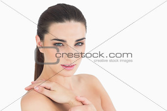 Woman touching her shoulder softly
