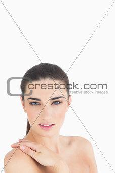 Woman feeling her shoulder