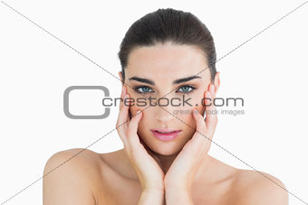Woman touching her cheek