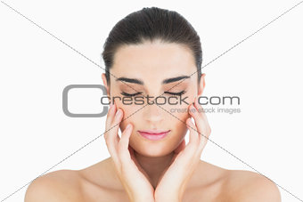 Woman touching her chin while looking natural