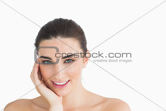 Female beauty leaning head on a hand