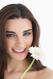 Smiling female beauty holding a flower