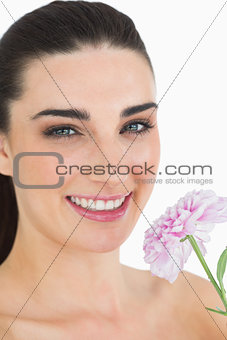 Pale woman showing a flower