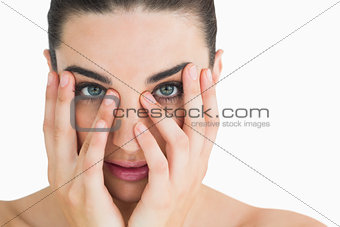 Pale woman touching her face