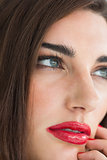 Brunette with red lips and nails
