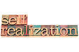 self-realization word in wood type