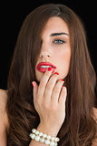 Woman touching her red lips