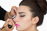 Woman getting applied cat eyes