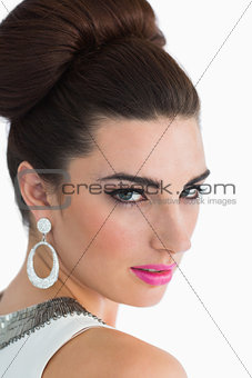 Sixties style woman looking over shoulder