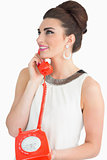 Sixties style woman using dial phone