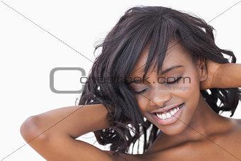 Woman ruffling her hair