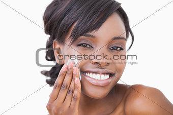 Woman using skin cream