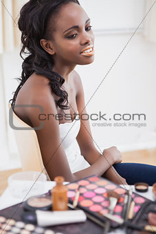 Woman sitting in chair waiting for makeup artist