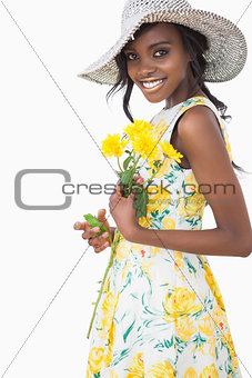 Woman standing holding flowers
