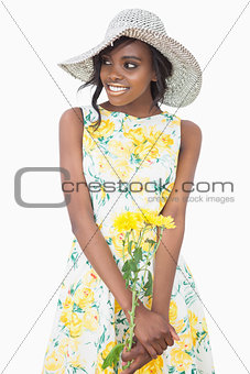 Woman standing wearing a floral dress