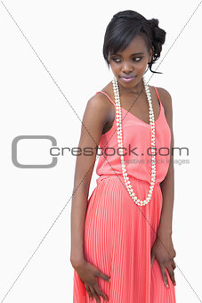 Woman posing in pearls and pink dress