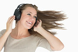 Smiling woman dancing with a headphone