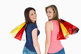 Two happy women with shopping bag