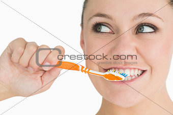 Cute woman washing her teeth