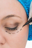 Doctor drawing around eye