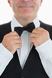 Waiter adjusting his bow tie