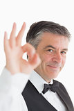 Smiling waiter making ok sign