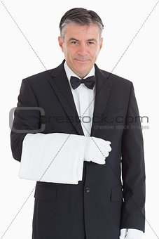 Smiling waiter holding a towel