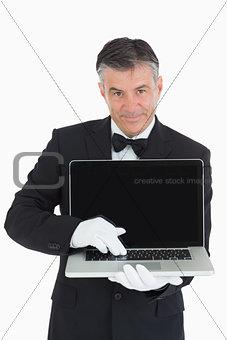 Waiter showing us something on a laptop