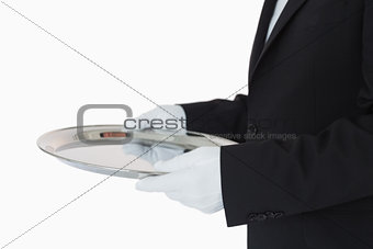 Man in suit holding silver tray