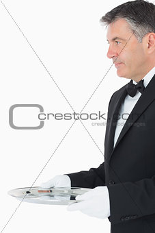 Waiter with a larger silver tray