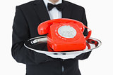 Red dial phone on a silver tray