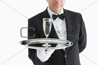 Man in suit serving glass with champagne