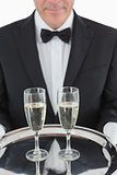 Man holding tray with champagne