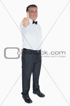Man in suit showing thumb up