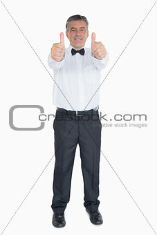 Man in suit showing both thumbs up