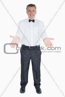 Man in a suit with open arms