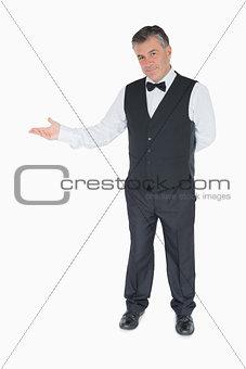 Man in suit showing something