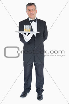 Man holding tray with glasses of whiskey
