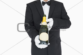 Waiter holding champagne bottle