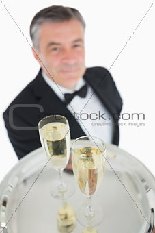 Close up of tray with glasses of champagne
