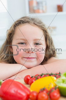Close up of girl leaning on table